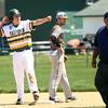 4-23-16<br /> Eastern vs Tri Central baseball<br /> Eastern's Manny Moreno celebrates from second base after hitting a double.<br /> Kelly Lafferty Gerber | Kokomo Tribune
