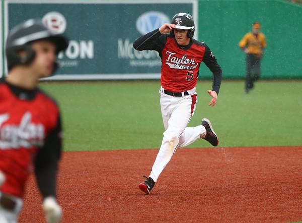 4-6-16<br /> Taylor vs Alexandria baseball<br /> Taylor's Stone Deckard runs to third after hitting a triple.<br /> Kelly Lafferty Gerber   Kokomo Tribune