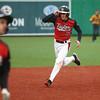 4-6-16<br /> Taylor vs Alexandria baseball<br /> Taylor's Stone Deckard runs to third after hitting a triple.<br /> Kelly Lafferty Gerber | Kokomo Tribune