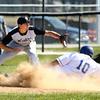 4-16-16<br /> Western vs Tipton baseball<br /> Tipton's Matt Gutierrez slides to third safely before Western's Kaleb Howard makes the catch.<br /> Kelly Lafferty Gerber | Kokomo Tribune