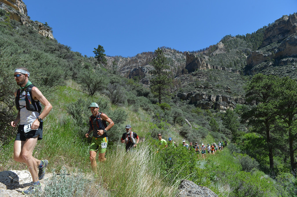 Justin Sheely | The Sheridan Press<br /> Runners go up the trail at the start of the 100-mile run during the annual Bighorn Mountain Wild and Scenic Trail Run Friday at Tongue River Canyon.