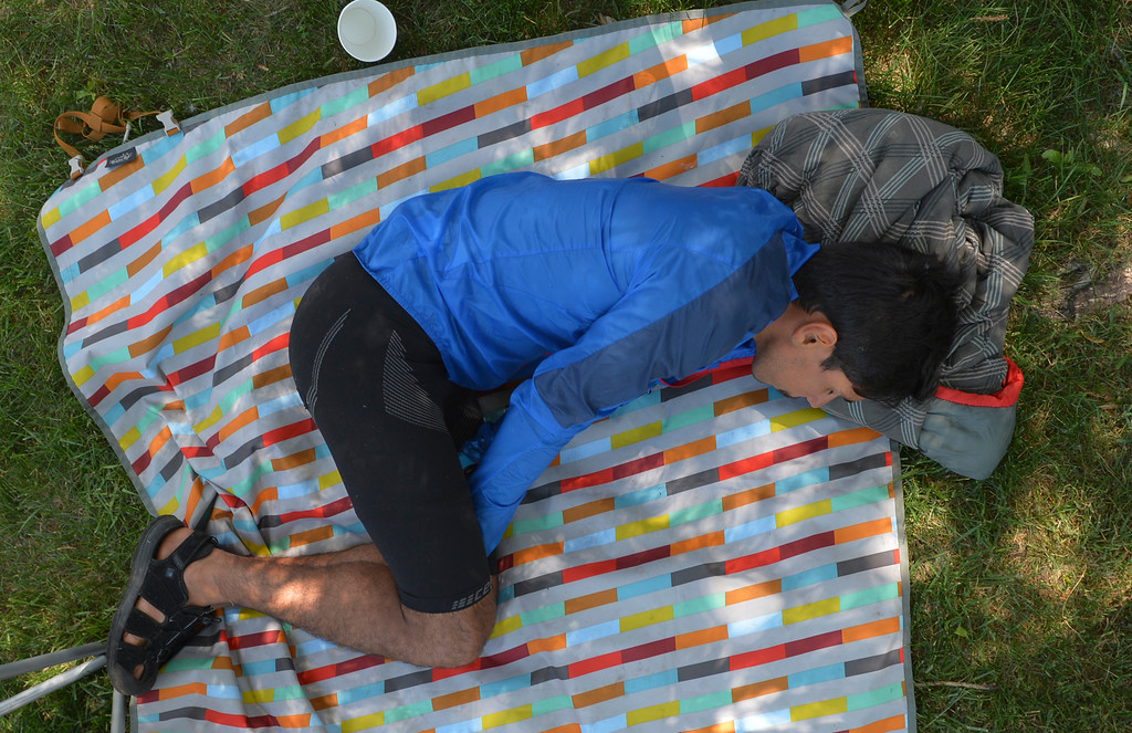 Justin Sheely | The Sheridan Press<br /> Nicholas Flores of Sheridan rests after finishing 21st in the 100-mile race during the Bighorn Mountain Wild and Scenic trail run Saturday at Scott Park in Dayton.