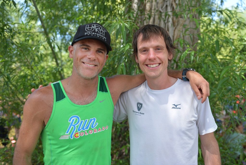 Justin Sheely | The Sheridan Press<br /> 52-mile overall winner Bryan Williams of Lafayette, Colorado, left, and 100-mile overall winner Seth Kelly, of Boulder, Colorado, pose for a photos by the finish line during the 2016 Bighorn Mountain Wild and Scenic trail run Saturday at Scott Park in Dayton.