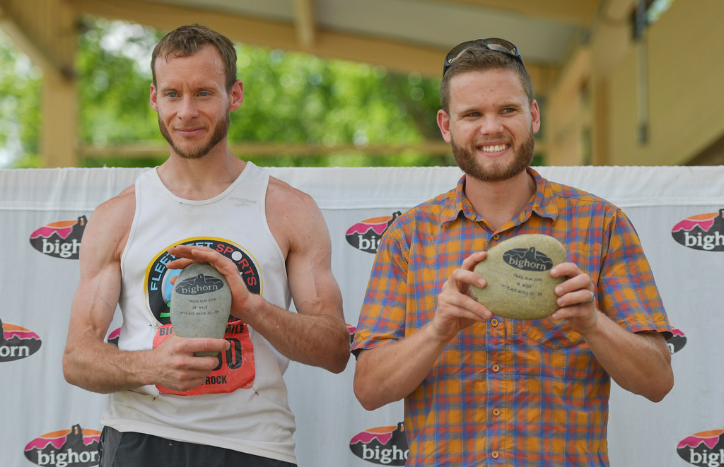 Justin Sheely | The Sheridan Press<br /> 18-mile overall winner Phil Rock, left, of Enumclaw, Washington, and second place overall, first place age 20 - 29, Clay Stoner, Sheridan, receive their awards during the 2016 Bighorn Mountain Wild and Scenic trail run Saturday at Scott Park in Dayton.