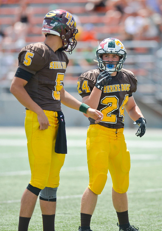 Mike Dunn | The Sheridan Press.<br /> Dillon Lyons, right, discusses the play with Collin Powers Saturday in Casper at the 43rd annual Shrine Bowl.