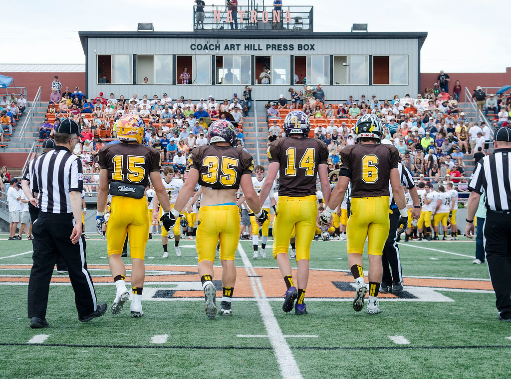 Mike Dunn | The Sheridan Press.<br /> North captains walk to the center of the field for the coin toss Saturday in Casper at the 43rd annual Shrine Bowl.
