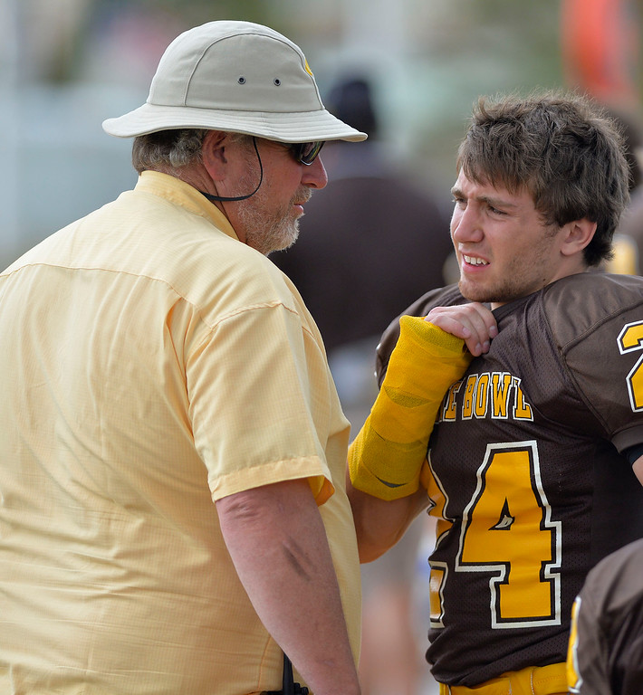 Mike Dunn | The Sheridan Press.<br /> Dillon Lyons chats with a trainer Saturday in Casper at the 43rd annual Shrine Bowl.