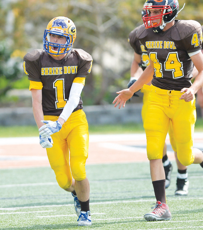 Mike Dunn | The Sheridan Press. <br /> Zach Campbell, left, celebrates after blocking a PAT Saturday in Casper at the 43rd annual Shrine Bowl.