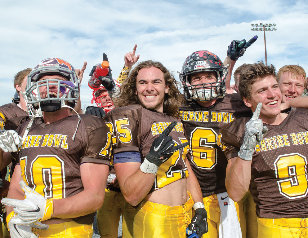Mike Dunn | The Sheridan Press. <br /> North players celebrate after their win Saturday in Casper at the 43rd annual Shrine Bowl.