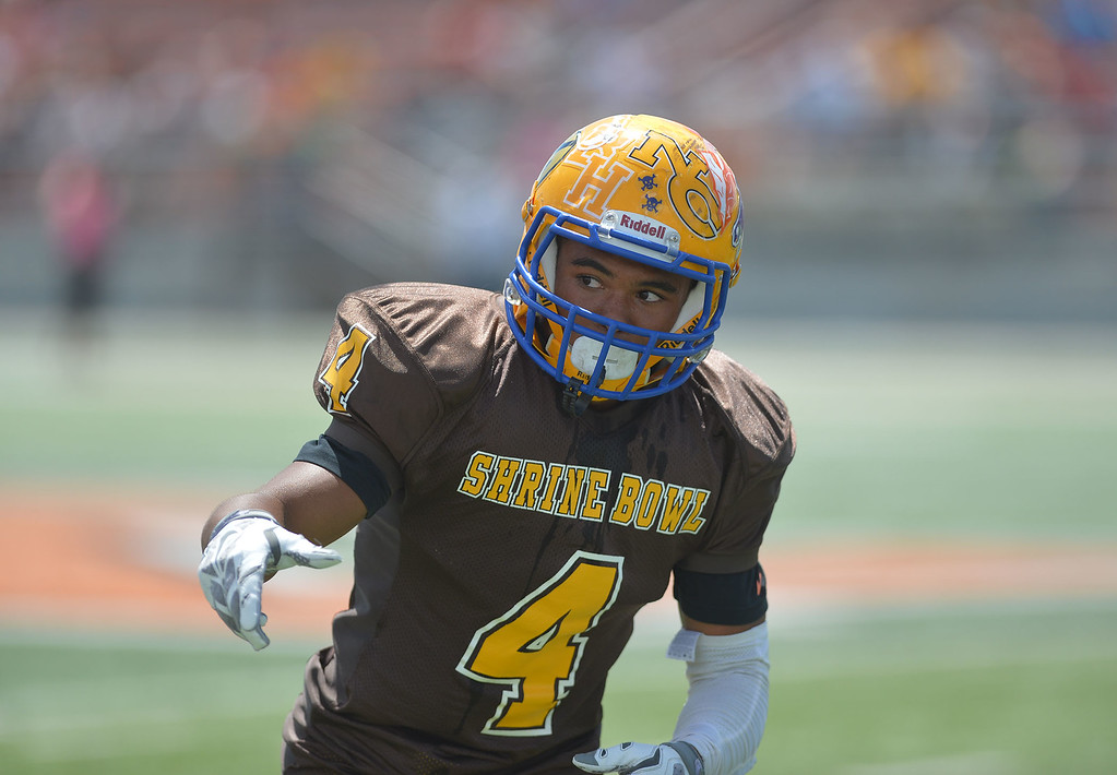 Mike Dunn | The Sheridan Press. <br /> Dontae Crow checks with the line judge Saturday in Casper at the 43rd annual Shrine Bowl.