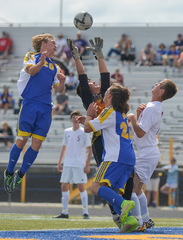 Justin Sheely | The Sheridan Press<br /> Sheridan Bronc players Dalton Legerski, left, and Brice Beisher content for the ball over Laramie's goalkeeper during the 4A East semifinal regional tournament Friday at Sheridan High School. Sheridan won 4-3.