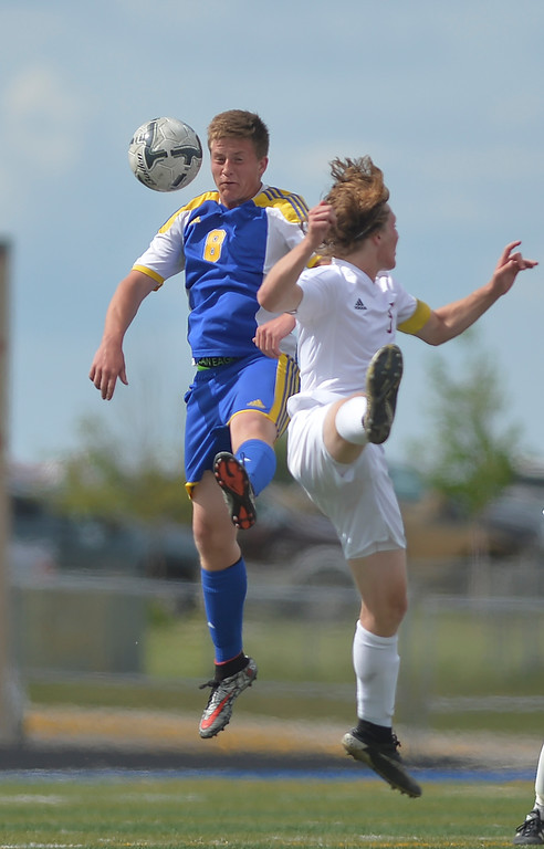 Justin Sheely | The Sheridan Press<br /> Broncs' Gregg Sampson gets a header over a Plainsman during the 4A East semifinal regional tournament Friday at Sheridan High School. Sheridan won 4-3.