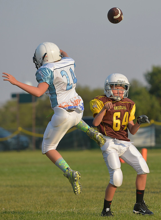 Justin Sheely | The Sheridan Press<br /> Tar Heels' Casen Wilson blocks a pass from Big Horn Grizzlies' Riley Green during 5th and 6th grade Little Guy Football Tuesday at Dan Madia Field.