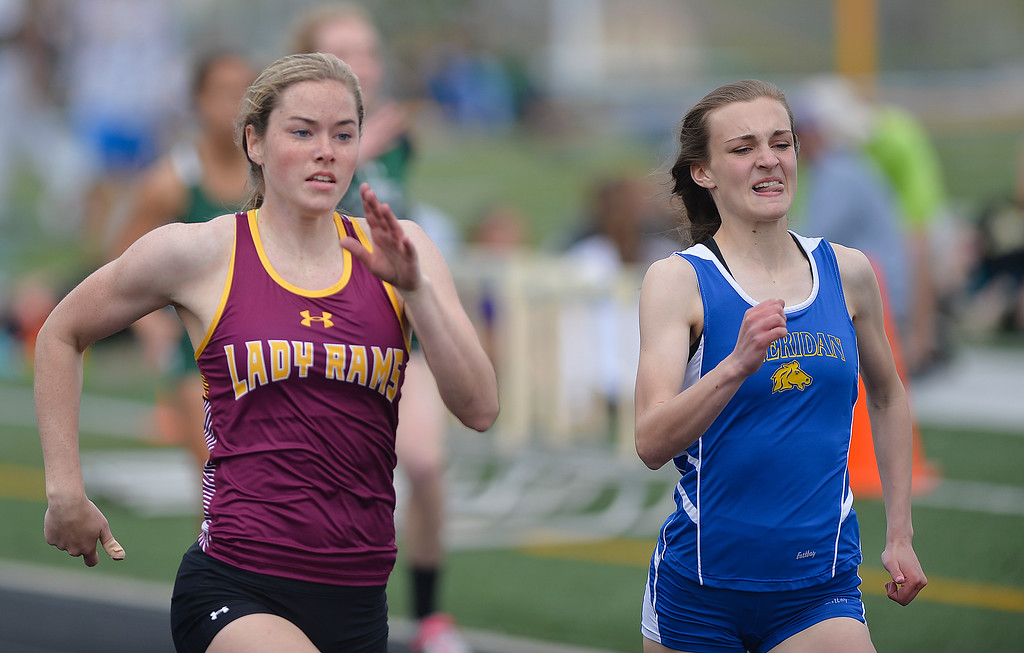 Justin Sheely | The Sheridan Press<br /> Lady Rams' Bailey Bard, left, overtakes Lady Broncs' Riley Rafferty win the 100 meter dash during the Dan Hansen track invite Saturday at Sheridan High School.