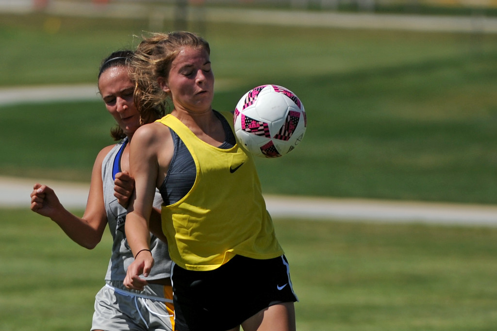 Sheridan High School's Talia Steel, right, takes a pass off the chest as Sheridan College's Destiny Lalaguna tries to steal possession during the Elite High School Camp on Friday, July 29 at Sheridan College. Mike Pruden | The Sheridan Press