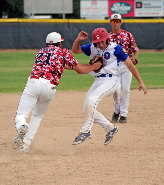Sheridan's Noah Gustafson, right, gets tagged running to third base on Tuesday, July 5 at Thorne-Rider Stadium. The Troopers split their doubleheader with the Gillette Roughriders. Mike Pruden | The Sheridan Press