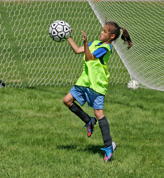 Goalkeeper Callista Roush deflects a shot during the Sheridan College Premier Soccer Camp on Tuesday, July 12 at Sheridan College. Mike Pruden | The Sheridan Press