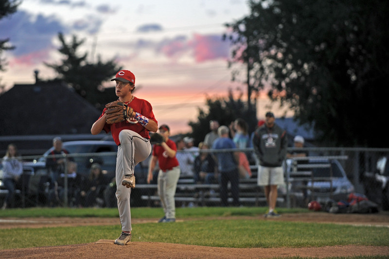 Michael Greer winds up to pitch in the Little League Minor League championship on Monday, July 11 at Oatts Fields. The Reds fell to the Cubs, 6-2.
