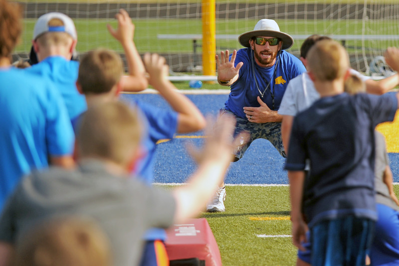 Sheridan High School assistant football coach Marshall McEwen demonstrates proper technique for a defensive lineman at the Sheridan High School football camp on Tuesday, July 19 at Homer Scott Field. Mike Pruden | The Sheridan Press