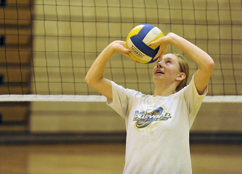 Mike Pruden | The Sheridan Press<br /> Peyton Bomar sets the ball to a teammate during a drill at volleyball camp Tuesday at Sheridan High School.
