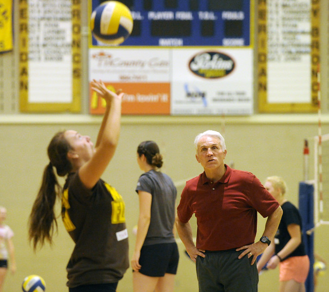 Former Idaho State volleyball coach Chad Teichert, right, watches as local volleyball players run through drills at his setters camp on Saturday, July 23 at Sheridan High School. Mike Pruden | The Sheridan Press
