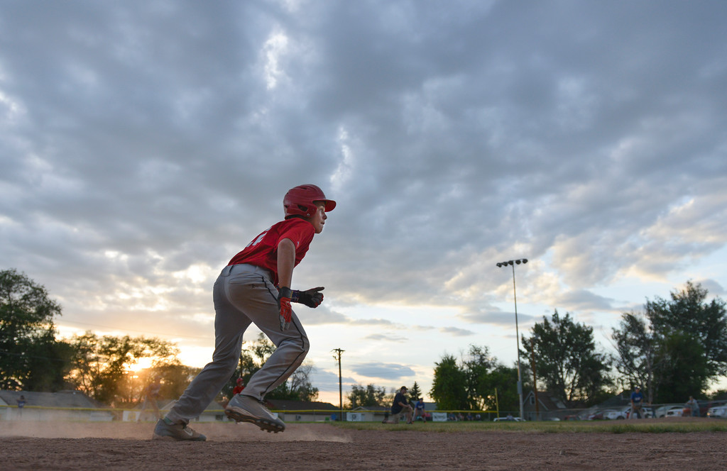 Justin Sheely | The Sheridan Press<br /> Reds player Michael Greer sneaks up on home for a 5th and 6th grade game against the Dodgers during the Sheridan Recreation District's Little League Baseball last June at Oatts fields.