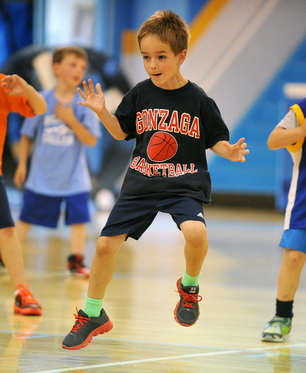 Luke McCarthy hopes to his left during a defensive-slide drill at the Sheridan College summer boys basketball camp on Tuesday, June 14 at the Bruce Hoffman Golden Dome. Mike Pruden | The Sheridan Press