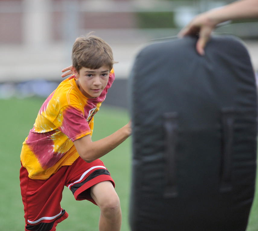 Robert Morton springs at a practice pad during a drill at the Justin O'Dell Memorial football camp on Thursday, June 9 at Big Horn High School. Mike Pruden | The Sheridan Press