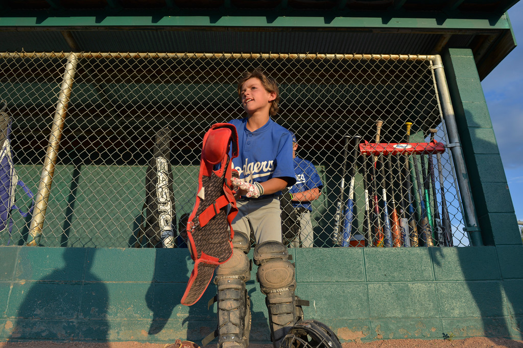 Justin Sheely | The Sheridan Press<br /> Dodgers' catcher Dane Steel puts his gear on as the Reds move to the plate for a 5th and 6th grade game during the Sheridan Recreation District's Little League Baseball Wednesday evening at Oatts fields.