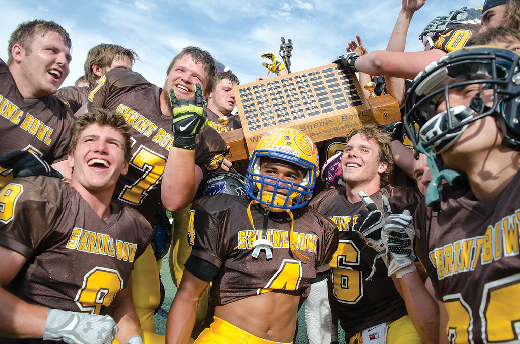 Mike Dunn | The Sheridan Press.<br /> North players celebrate after their win Saturday in Casper at the 43rd annual Shrine Bowl.