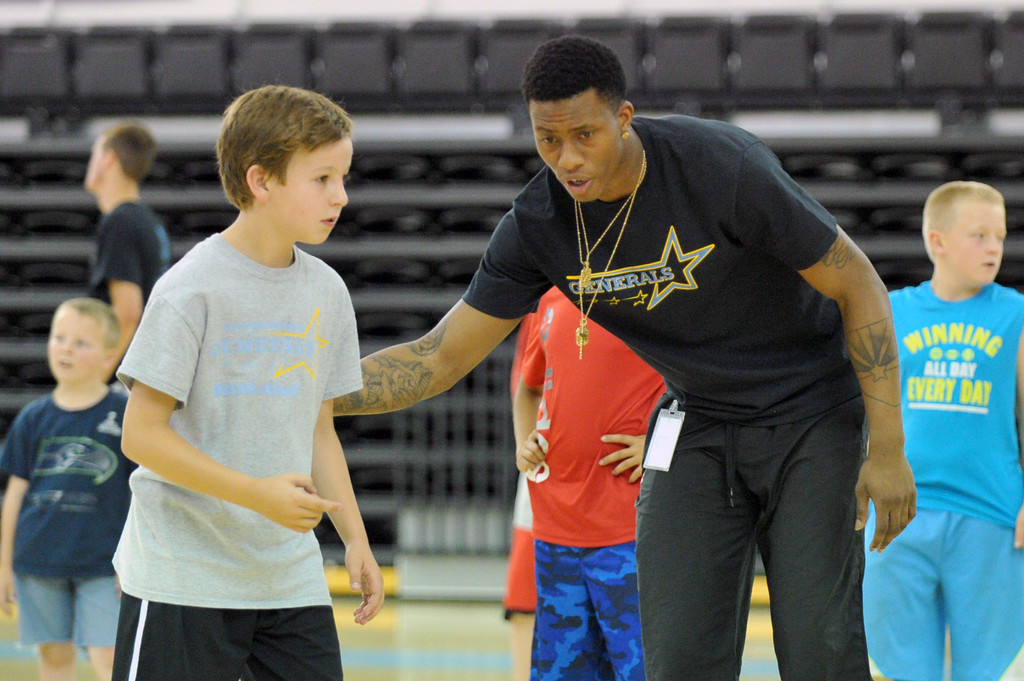 Sheridan College men's basketball player Montrail Johnson, right, instructs camper Mason Manning at the Sheridan College summer boys basketball camp on Tuesday, June 14 at the Bruce Hoffman Golden Dome. Mike Pruden | The Sheridan Press