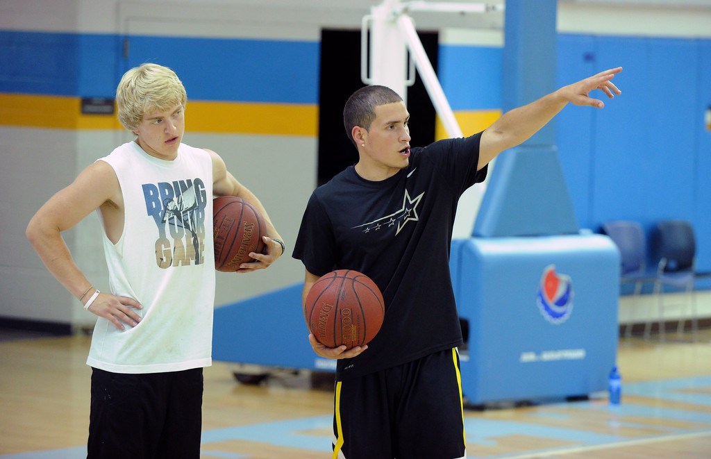 Sheridan College's Celio Araujo, right, points out instructions to Big Horn's Colton Bates during the Sheridan College men's basketball Elite Camp on Monday, June 27 at the Bruce Hoffman Golden Dome. Mike Pruden | The Sheridan Press