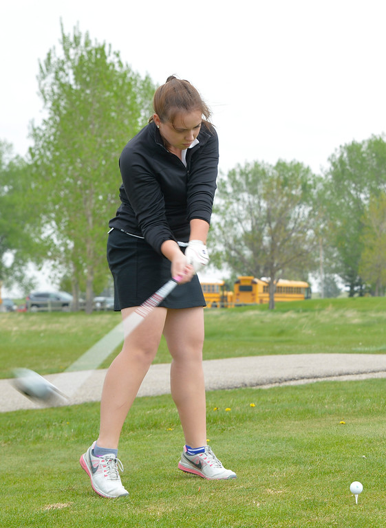 Justin Sheely | The Sheridan Press<br /> Sheridan Lady Bronc Molly Butler tees off during high school golf Friday at Kendrick Golf Course.