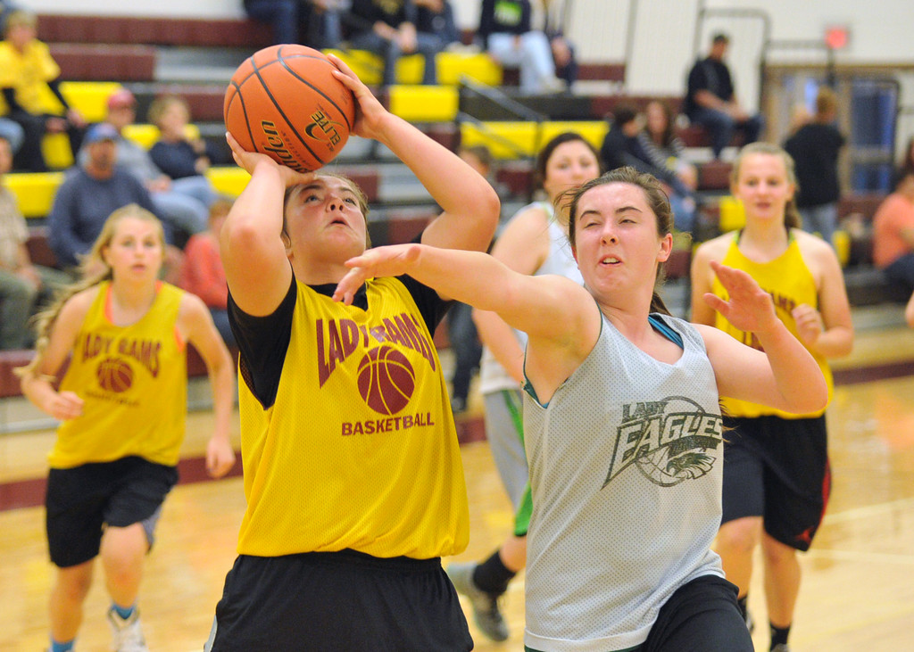 Big Horn's Shyan Davidson, left, shoots the ball over defender Jenna Keller on Tuesday, May 31 at Big Horn High School. The two teams scrimmaged as part of an ongoing summer series that includes Buffalo and Worland. Mike Pruden | The Sheridan Press