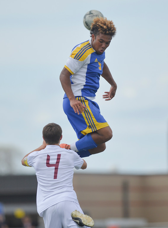 Justin Sheely | The Sheridan Press<br /> Broncs' Dontae Crow gets some air over a Plainsman during the 4A East semifinal regional tournament Friday at Sheridan High School. Sheridan won 4-3.