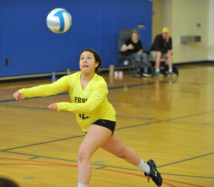 Cece Sterbert of Gillette's Powder River Volleyball Club lunges to keep the ball in play during Sunday's championship match at the Never Flinch volleyball tournament at Sheridan Junior High School. Eighty-one teams from across the state competed in the tournament, which donates proceeds from the event to the Never Flinch Foundation Scholarship Fund in memory of Weston Johnson. Johnson was a Sheridan High School Football coach who passed away from Melanoma in January 2014. The Never Flinch Foundation awards scholarships to Sheridan High School and Wray (Colorado) High School students. The Sheridan Volleyball Club has hosted five tournaments over the last three years and has given over $4,000 to The Never Flinch Foundation. The SVC is hoping to donate between $2,000 and $4,000 this year to Never Flinch.