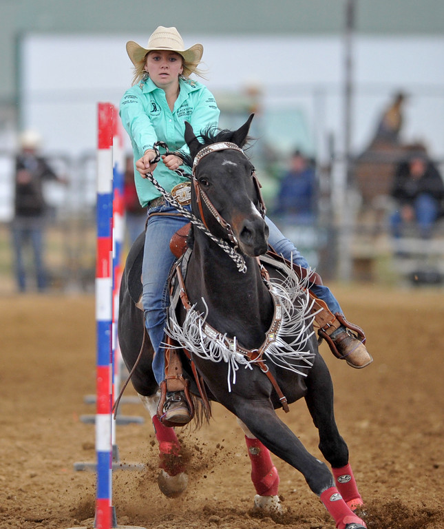 Jenna Hoffman works her way in and out of the poles during the pole bending competition at the Sheridan County high school rodeo on Monday, May 30 at the Sheridan County Fairgrounds. Mike Pruden | The Sheridan Press