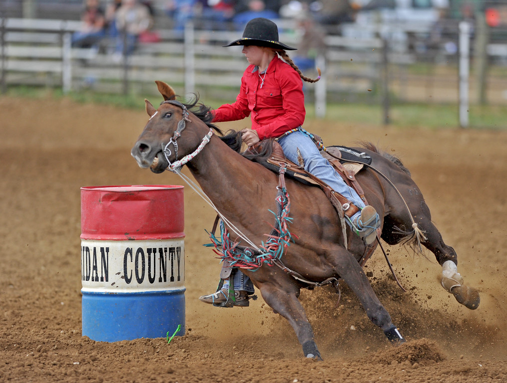 Shaylee Adamson and her horse kick up dirt as they whip around a barrel at the Sheridan County high school rodeo on Monday, May 30 at the Sheridan County Fairgrounds. Mike Pruden | The Sheridan Press