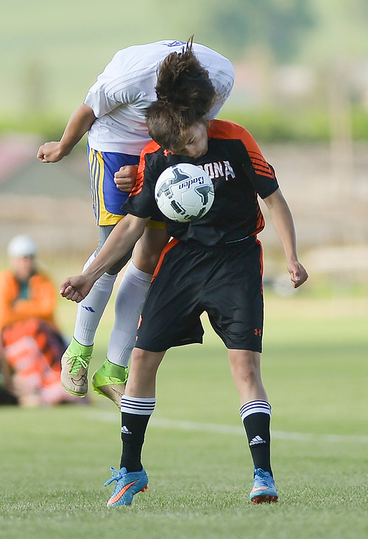 Justin Sheely | The Sheridan Press<br /> Broncs' Brice Beisher gets physical with header during the first round of the 4A state tournament Thursday at the Big Horn Equestrian Center in Sheridan County. Sheridan won with a free kick 1-0 in the second half.