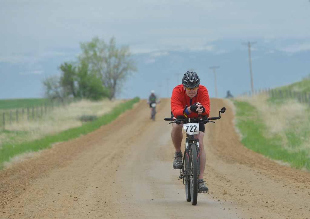Justin Sheely | The Sheridan Press<br /> Chad Birdie coasts down the road during the Beaver Creek Slide and Bike Slog event Saturday near Beaver Creek Road. This is the 13th year, and possibly the last year, the Beaver Creek Slide has been held to benefit the VOA Sheridan Community Shelter.