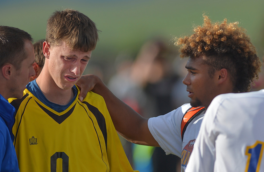Justin Sheely | The Sheridan Press<br /> Broncs goalkeeper Zach Campbell, left, and Dontae Crow exchange works after losing to the Plainsmen in the semifinal round of the boys 4A state tournament at the Big Horn Equestrian Center. Sheridan was defeated by Laramie in an overtime penalty kick, 1-0.