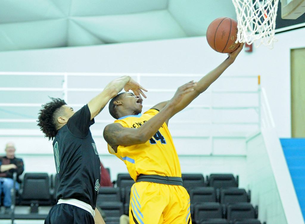 Xavier Jackson takes a smack across the face as he lays the ball up on a fast break on Friday, Nov. 25 at the Bruce Hoffman Golden Dome. Mike Pruden | The Sheridan Press