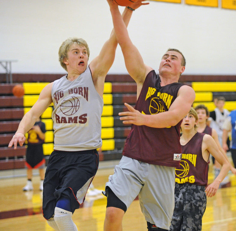 Colton Bates, left, reaches to block Nolan McCafferty's layup attempt during practice on Wednesday, Nov. 30 at Big Horn High School. Mike Pruden | The Sheridan Press