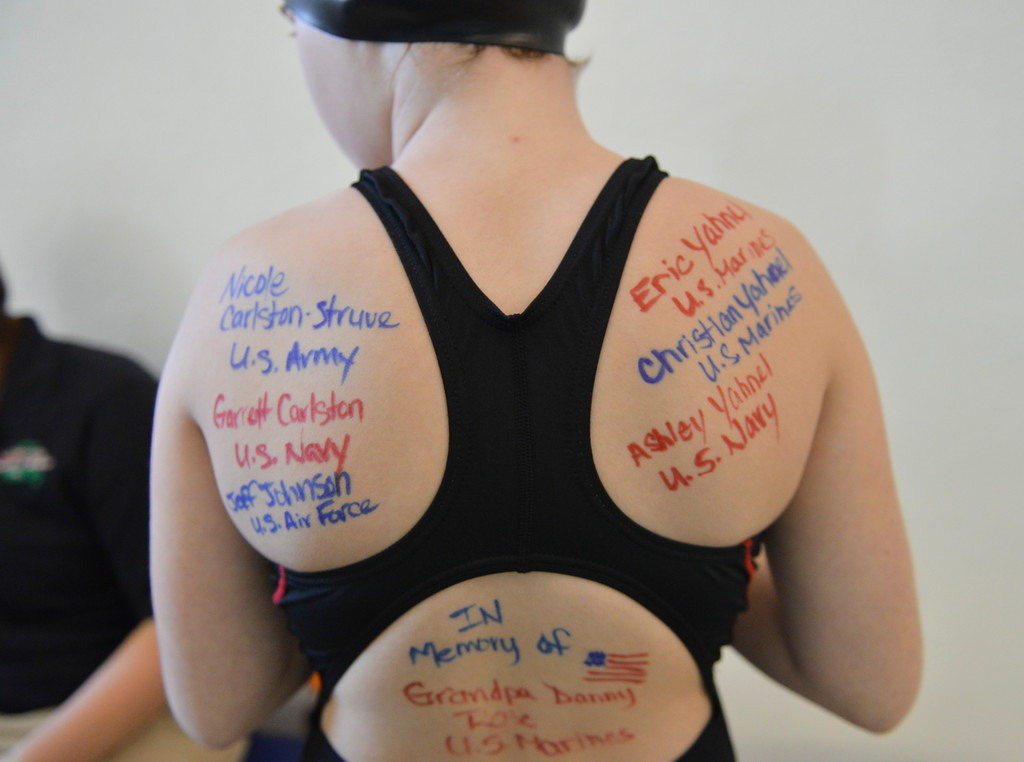 Justin Sheely | The Sheridan Press<br /> Gillette team swimmer Josilyn Yahnel shows off names of military service members written on her back during the Salute to Veterans Sheridan Swim Meet Saturday at the Sheridan Junior High School pool. The Sheridan Swim Team Sharks hosted the meet to collect donations for the Student Veterans of America at Sheridan College and veterans in the community.