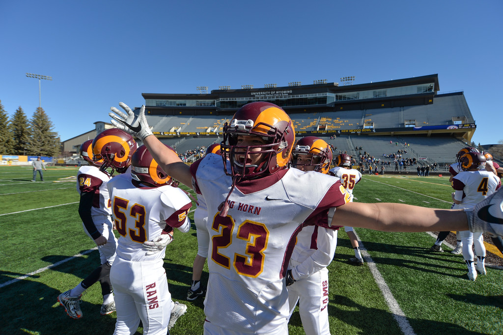 Justin Sheely | The Sheridan Press<br /> Kade Eisele and the Rams celebrate after defeating Greybull during the Class 2A State Championship Saturday, Nov. 12 at War Memorial Stadium in Laramie. The Rams beat the Buffaloes 28-20 to take the state title.