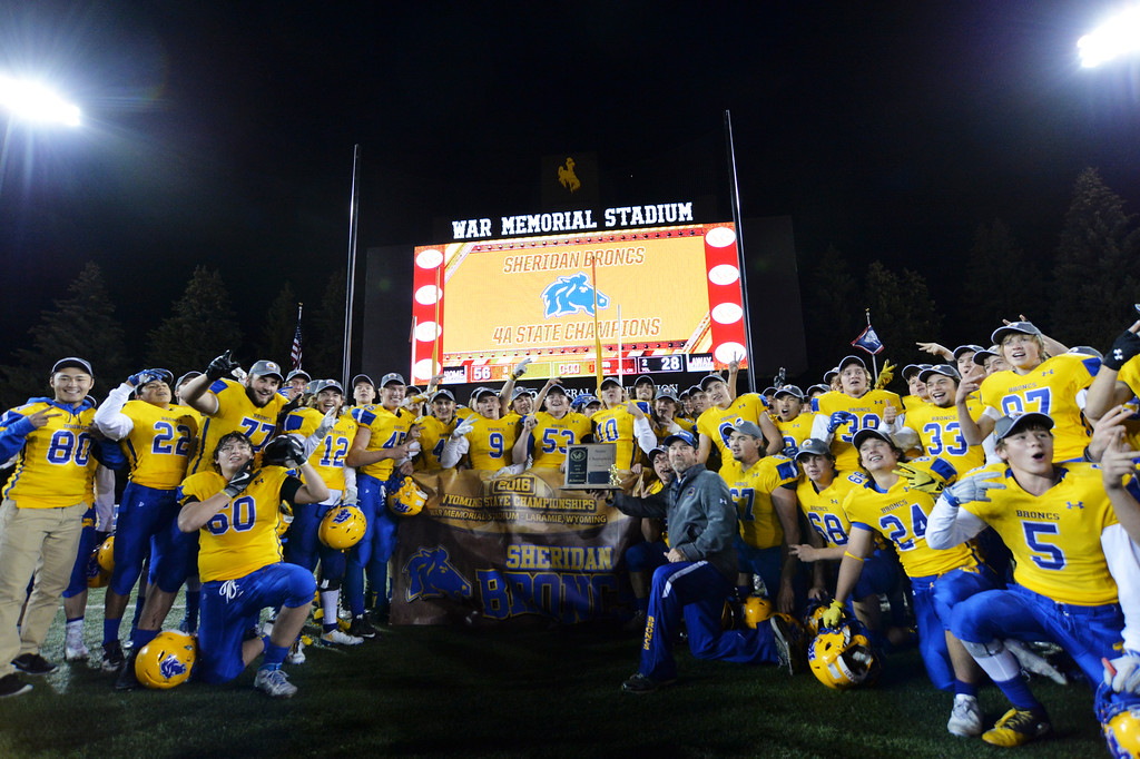 Justin Sheely | The Sheridan Press<br /> Sheridan poses for photos after winning the Class 4A State Championship Saturday at War Memorial Stadium in Laramie. The Broncs beat Natrona County 56-28 for a back-to-back state title.