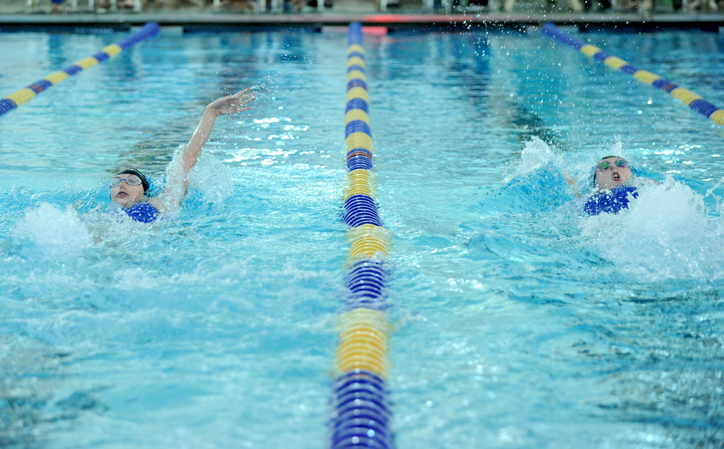 Sheridan's Piper Carroll, left, and Molly Green compete against each other in the 100-meter backstroke at the Sheridan Invite on Saturday, Sept. 24 at Sheridan Junior High School. Carroll just edged Green to win the race. Mike Pruden | The Sheridan Press