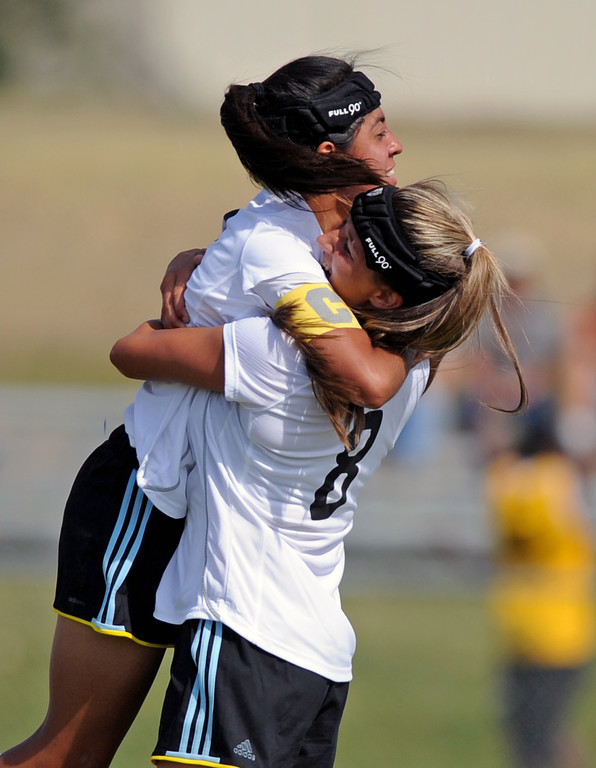 Sheridan College's Sidney Burrell, right, embraces Ana Sanchez after Sanchez's 54th-minute goal on Saturday, Sept. 3 at Maier Field. Mike Pruden | The Sheridan Press