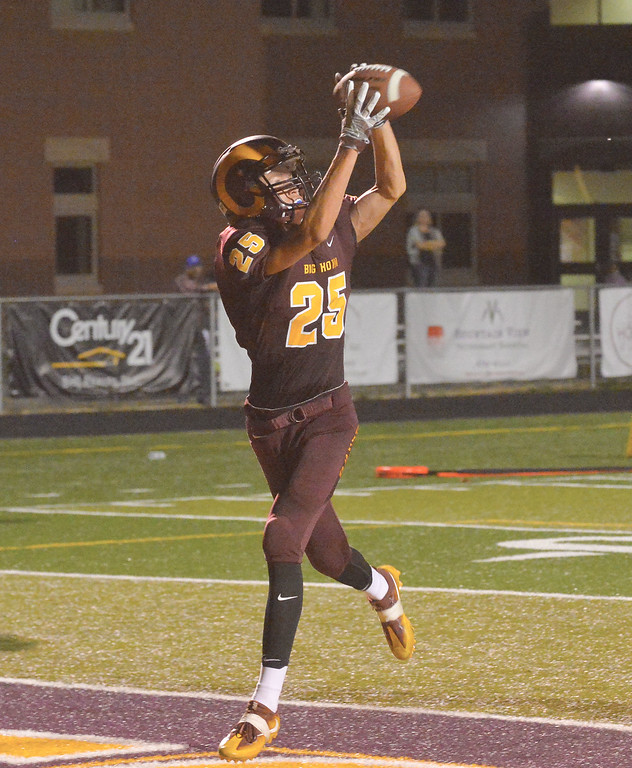 Mike Dunn | The Sheridan Press. <br /> Kade VanDyken catches a touchdown pass Friday against the Lovell Bulldogs at Big Horn High School.