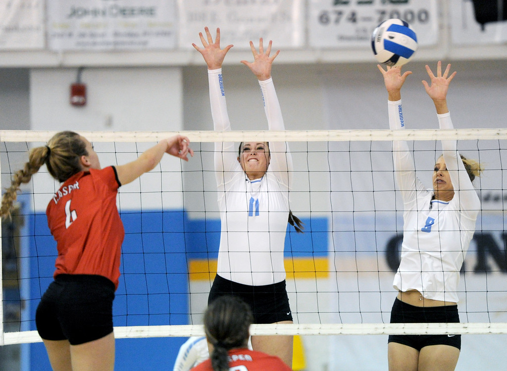 Sheridan College's Kiersten Leach, right, and Ally Gates, center, jump to block a Sydney Nielsen spike on Tuesday, Sept. 27 at the Bruce Hoffman Golden Dome. Mike Pruden | The Sheridan Press